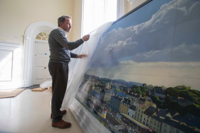 "05/09/2016. FREE TO USE IMAGE. Pictured at City Hall, Waterford City at the installation of ""Waterford 2016"" painting by by Irish artist, Blaise Smith which is 5 metres in length. Picture: Patrick Browne The Office of Public Works and Waterford City & County Council today unveiled a commissioned piece by Irish artist, Blaise Smith, under the Per Cent for Art Scheme for flood defence works. The new large-scale painting reflects a 21st century view of Waterford city and is entitled ""Waterford 2016"". It is 5 metres in length and comprised of 52 panels, and acts as a companion painting to the 1735 commission by Waterford Corporation, (as it was then known), from a Dutch painter William Van der Hagen (d. 1745). Blaise Smith has taken his view from the same vantage point; showing the city from across the river Suir as it stands today, with all the changes that have taken place over the span of two hundred and eighty years."